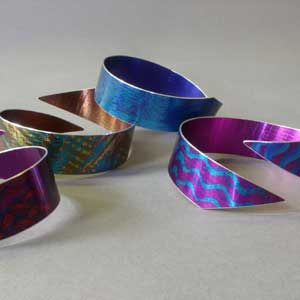 abstract bangles in anodised aluminium by Mandy Nash